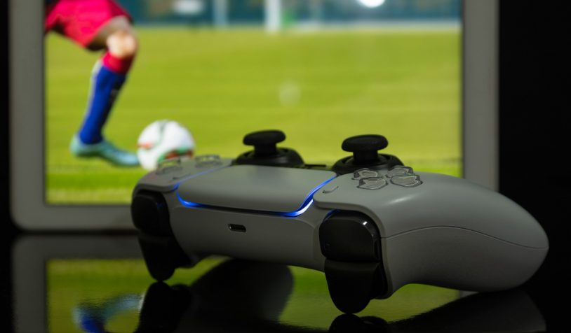 gen-game-controller-with-football-game-screen